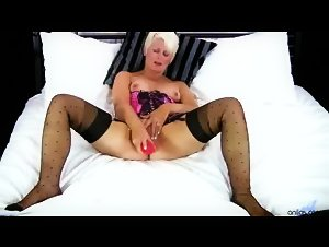 Horny older cougar loves huge toy